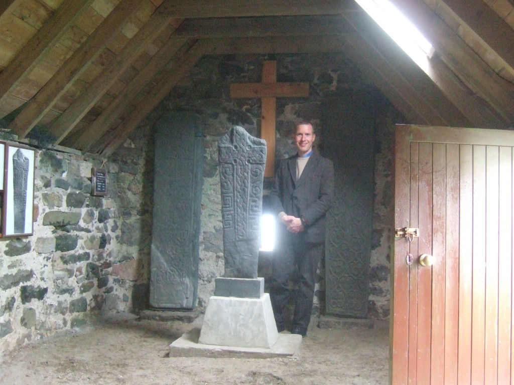 Inside Kilbarr chapel, with two late medieval carved graveslabs, as well as the Viking runestone.