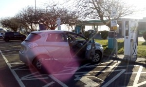 Charging the electric car at the Ecotricity fast charging station, at Kinross services.