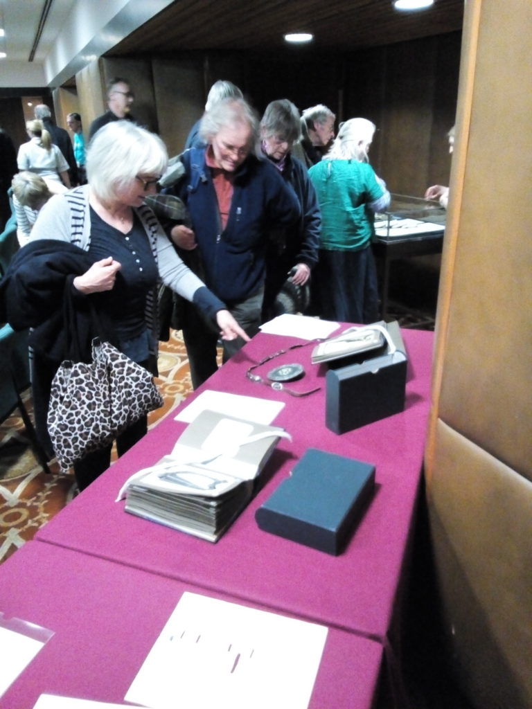 Members of the audience inspecting Heloise's memorabilia after the talk