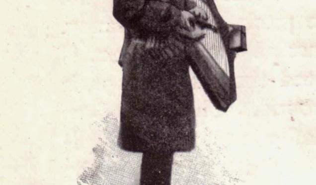 Irish harpist busking in London, c.1900