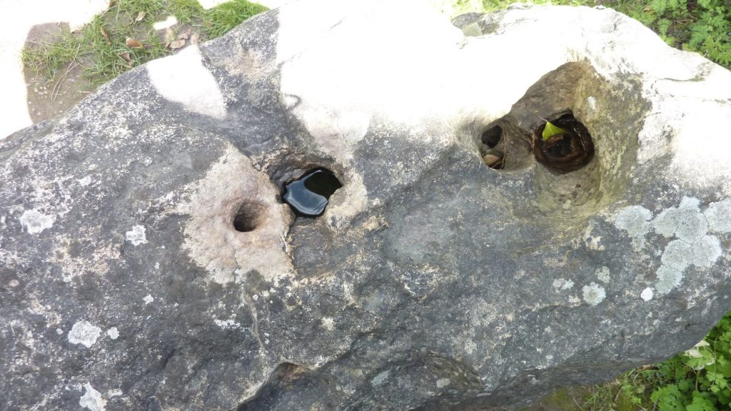 """""""mouthpiece"""" of the blowing stone (left-most hole)"""